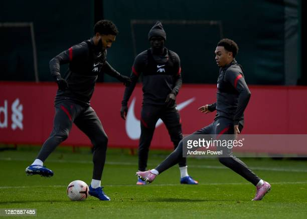 Joe Gomez and Trent AlexanderArnold of Liverpool during a training session at Melwood Training Ground on October 29 2020 in Liverpool England