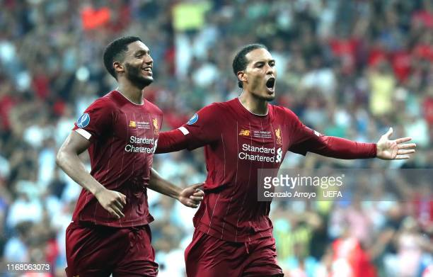 Joe Gomez and Virgil van Dijk of Liverpool celebrate victory after the penalty shoot out following the UEFA Super Cup match between Liverpool and...
