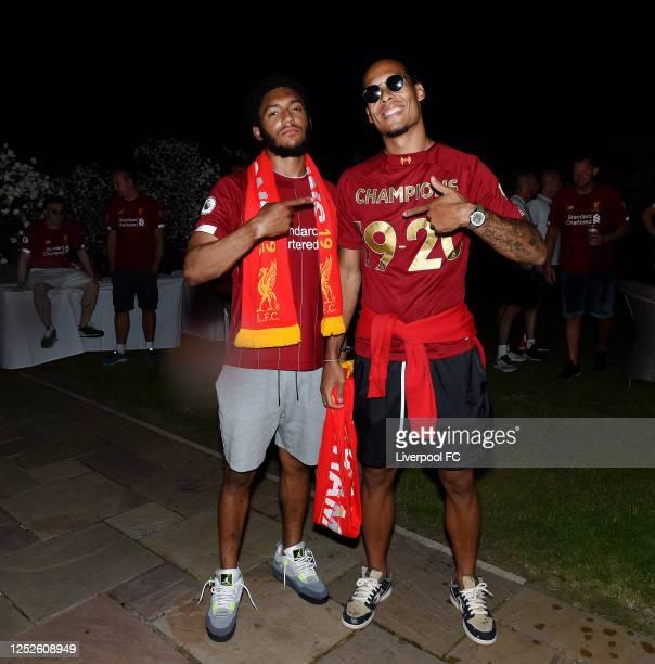 Joe Gomez and Virgil van Dijk of Liverpool celebrating winning the Premier League on June 25, 2020 in Liverpool, England.