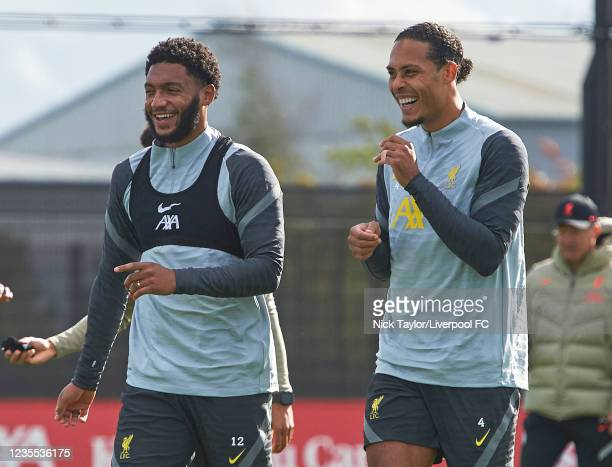 Joe Gomez and Virgil Van Dijk of Liverpool during a training session at AXA Training Centre on September 27, 2021 in Kirkby, England.