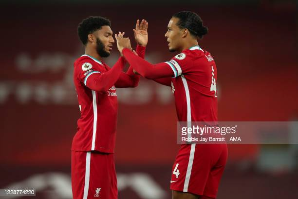 Joe Gomez and Virgil Van Dijk of Liverpool during the Premier League match between Liverpool and Arsenal at Anfield on September 28, 2020 in...