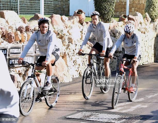 Joe Gomez Georginio Wijnaldum and Virgil van Dijk of Liverpool arrives on a bike before a training session at Marbella Football Center on February 17...