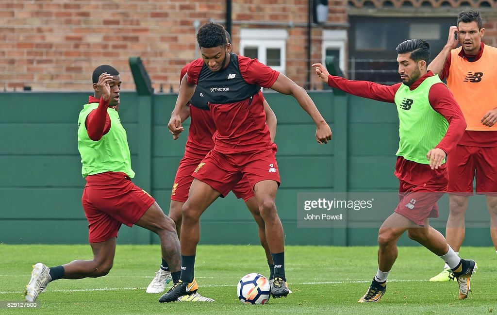 Joe Gomez gets between Georginio Wijnaldum and Emre Can of Liverpool during a training session at Melwood Training Ground on August 10, 2017 in Liverpool, England.