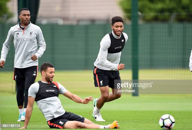 Joe Gomez goes past Kevin Stewart of Liverpool during a training session at Melwood Training Ground on May 17, 2017 in Liverpool, England.