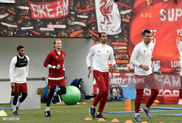 Joe Gomez Loris Karius Joel Matip and Dejan Lovren of Liverpool during a training session at Melwood Training Ground on March 13 2018 in Liverpool...