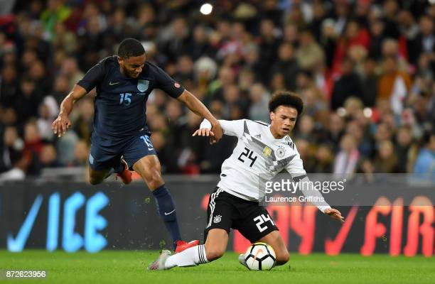 Joe Gomez of England and Leroy Sane of Germany battle for possession during the International friendly match between England and Germany at Wembley...