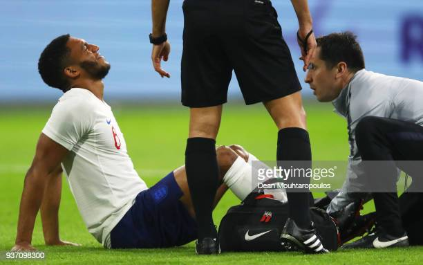 Joe Gomez of England is given treatment during the international friendly match between Netherlands and England at Johan Cruyff Arena on March 23...