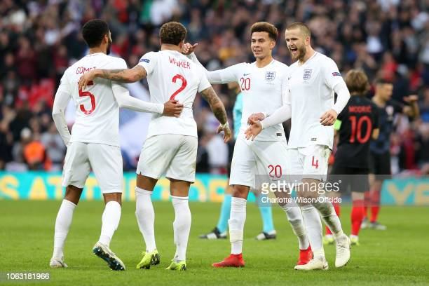 Joe Gomez of England Kyle Walker of England Dele Alli of England and Eric Dier of England celebrate their 21 win during the UEFA Nations League A...