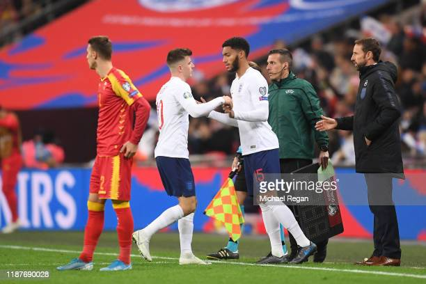 Joe Gomez of England replaces Mason Mount of England during the UEFA Euro 2020 qualifier between England and Montenegro at Wembley Stadium on...