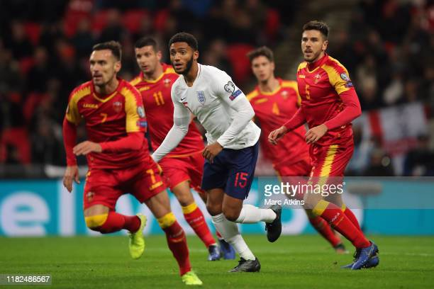 Joe Gomez of England surrounded by opposition players during the UEFA Euro 2020 qualifier between England and Montenegro at Wembley Stadium on...