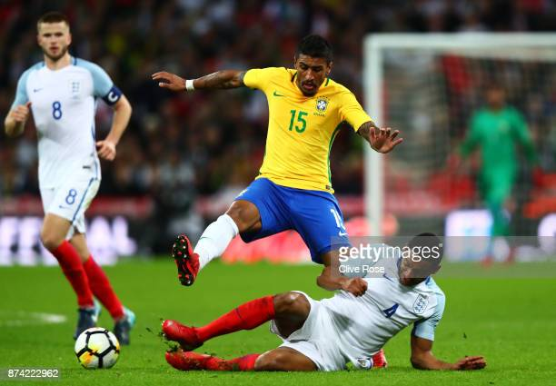 Joe Gomez of England tackles Paulinho of Brazil during the international friendly match between England and Brazil at Wembley Stadium on November 14...