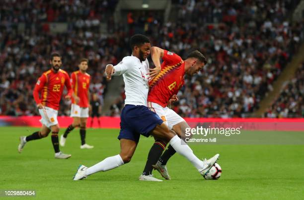 Joe Gomez of England tackles Saul Niguez of Spain during the UEFA Nations League A group four match between England and Spain at Wembley Stadium on...