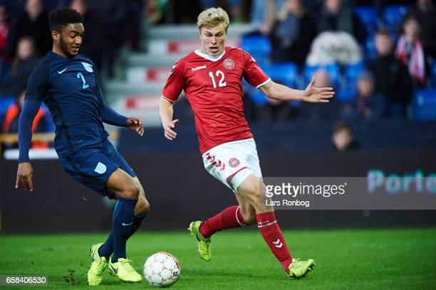 Joe Gomez of England U21 and Rasmus Nissen Kristensen of Denmark U21 compete for the ball during the U21 International friendly match between Denmark...