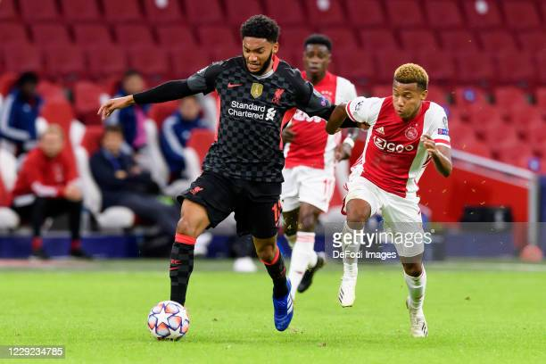 Joe Gomez of FC Liverpool and David Neres of Ajax Amsterdam battle for the ball during the UEFA Champions League Group D stage match between Ajax...