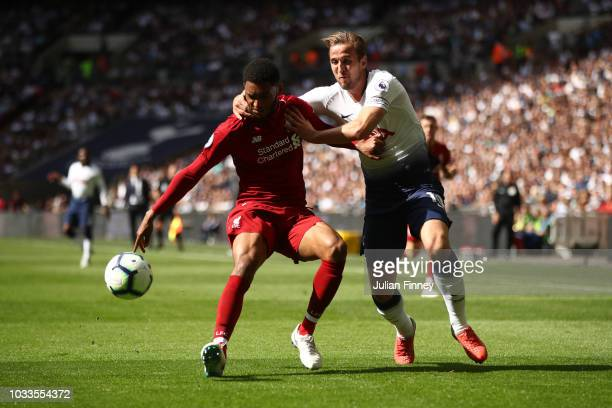 Joe Gomez of Liverpool and Harry Kane of Tottenham Hotspur battle for the ball during the Premier League match between Tottenham Hotspur and...