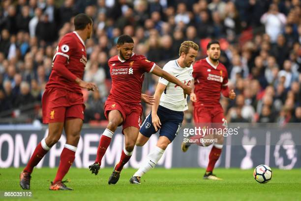 Joe Gomez of Liverpool and Harry Kane of Tottenham Hotspur battle for possession during the Premier League match between Tottenham Hotspur and...