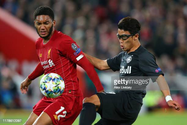Joe Gomez of Liverpool and Hwang Heechan of Red Bull Salzburg during the UEFA Champions League group E match between Liverpool FC and RB Salzburg at...