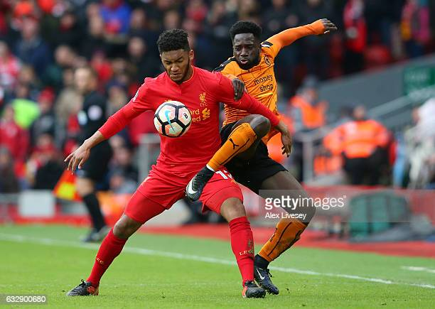 Joe Gomez of Liverpool and Nouha Dicko of Wolverhampton Wanderers compete for the ball during the Emirates FA Cup Fourth Round match between...