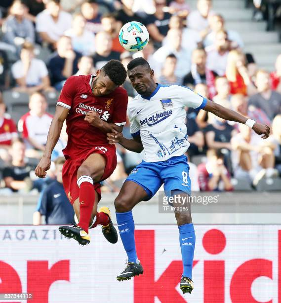 Joe Gomez of Liverpool and Salomon Kalou of Hertha battle for the ball during the Preseason Friendly match between Hertha BSC and FC Liverpool at...