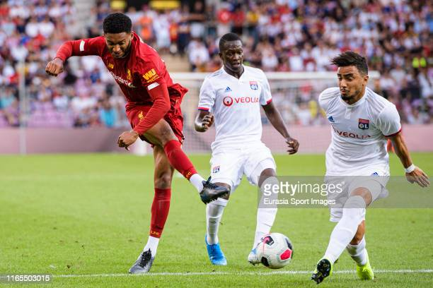 Joe Gomez of Liverpool attempts a kick while being defended by Rafael da Silva of Olympique Lyon during the Pre-Season Friendly match between...