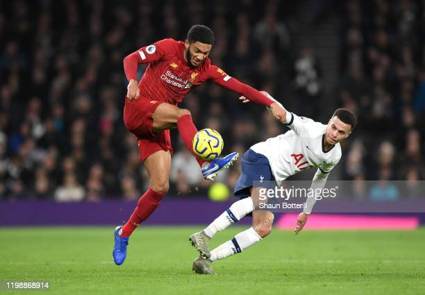 Joe Gomez of Liverpool battles for possession with Dele Alli of Tottenham Hotspur during the Premier League match between Tottenham Hotspur and...
