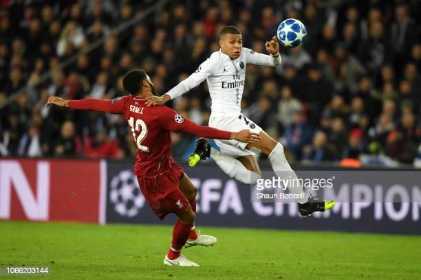 Joe Gomez of Liverpool battles for possession with Kylian Mbappe of Paris SaintGermain during the UEFA Champions League Group C match between Paris...