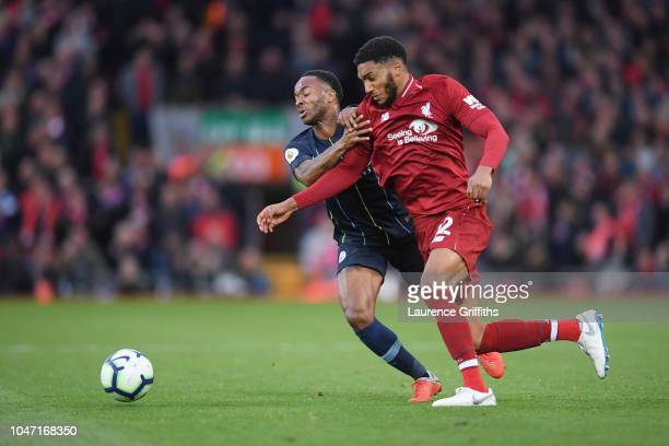 Joe Gomez of Liverpool battles for possession with Raheem Sterling of Manchester City during the Premier League match between Liverpool FC and...
