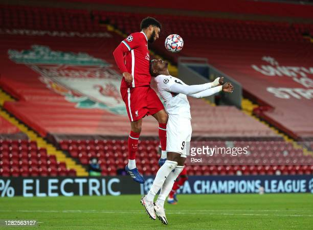 Joe Gomez of Liverpool battles for possession with Sory Kaba of FC Midtjylland during the UEFA Champions League Group D stage match between Liverpool...