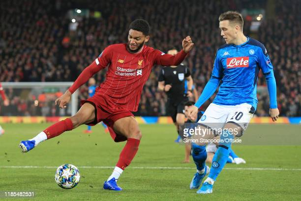 Joe Gomez of Liverpool battles with Piotr Zielinski of Napoli during the UEFA Champions League group E match between Liverpool FC and SSC Napoli at...