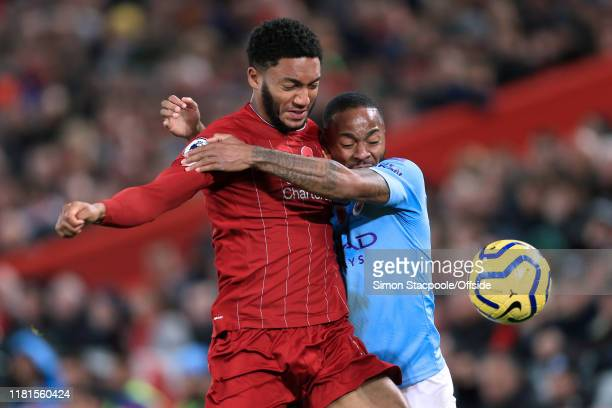 Joe Gomez of Liverpool battles with Raheem Sterling of Man City during the Premier League match between Liverpool FC and Manchester City at Anfield...