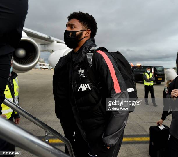 Joe Gomez of Liverpool boarding a plane ahead of the UEFA Champions League Group D stage match between Liverpool FC and Atalanta BC at Liverpool John...