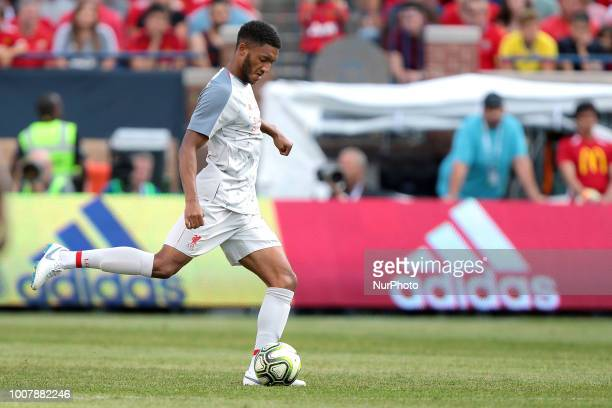 Joe Gomez of Liverpool carries the balll up the field during an International Champions Cup match between Manchester United and Liverpool at Michigan...