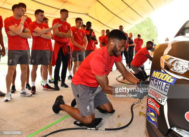 Joe Gomez of Liverpool changing tyres during a tour of Roush Fenway Racing on July 21 2018 in Charlotte North Carolina