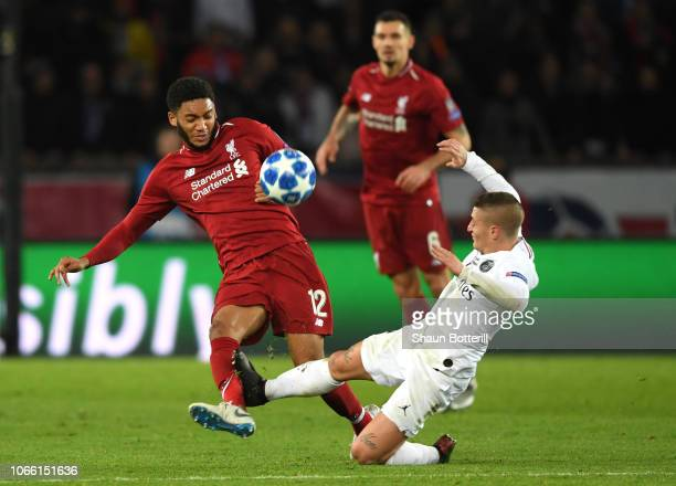 Joe Gomez of Liverpool collides with Marco Verratti of Paris SaintGermain during the UEFA Champions League Group C match between Paris SaintGermain...