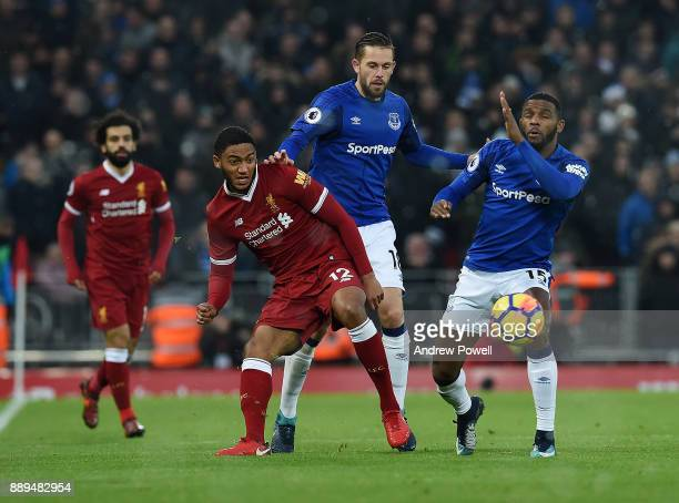 Joe Gomez of Liverpool competes with Cuco Martina and Gylfi Sigurdsson of Everton during the Premier League match between Liverpool and Everton at...