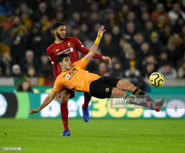 Joe Gomez of Liverpool competing with Raul Jimenez of Wolverhampton Wanderers during the Premier League match between Wolverhampton Wanderers and...