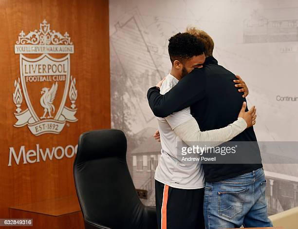 Joe Gomez of Liverpool embracing Jurgen Klopp manager of Liverpool after signing a new contract at Melwood Training Ground on January 27 2017 in...