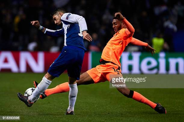 Joe Gomez of Liverpool FC competes for the ball with Alex Telles of FC Porto during the UEFA Champions League Round of 16 First Leg match between FC...