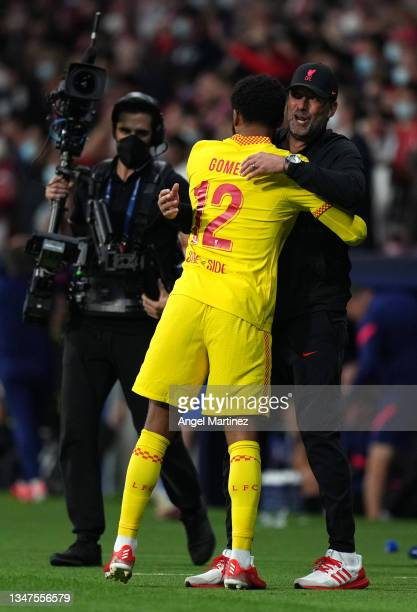 Joe Gomez of Liverpool hugs Jurgen Klopp, Manager of Liverpool after the UEFA Champions League group B match between Atletico Madrid and Liverpool FC...