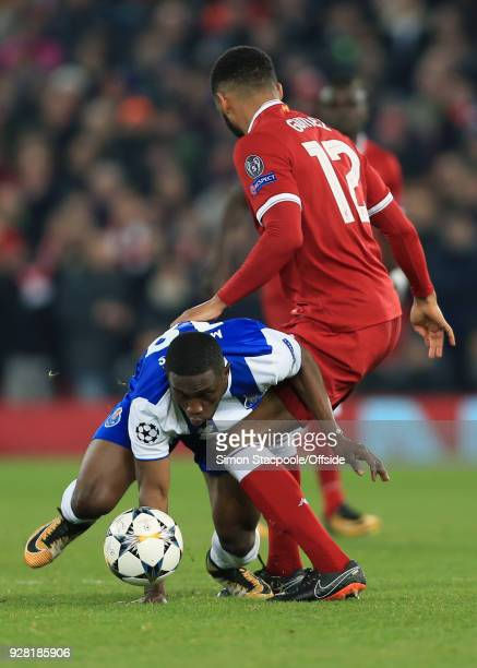 Joe Gomez of Liverpool in action with Majeed Waris of FC Porto during the UEFA Champions League Round of 16 Second Leg match between Liverpool and FC...
