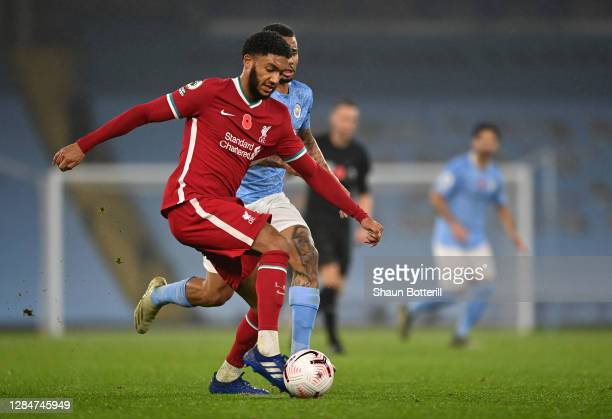 Joe Gomez of Liverpool is challenged by Gabriel Jesus of Manchester City during the Premier League match between Manchester City and Liverpool at...