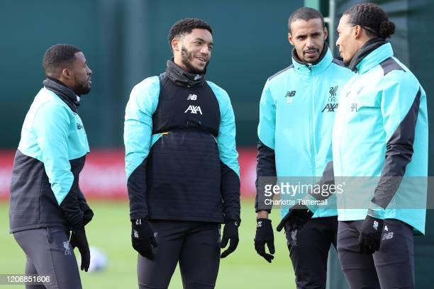 Joe Gomez of Liverpool laughs with teammates during a training session at Melwood Training Ground on February 17 2020 in Liverpool United Kingdom