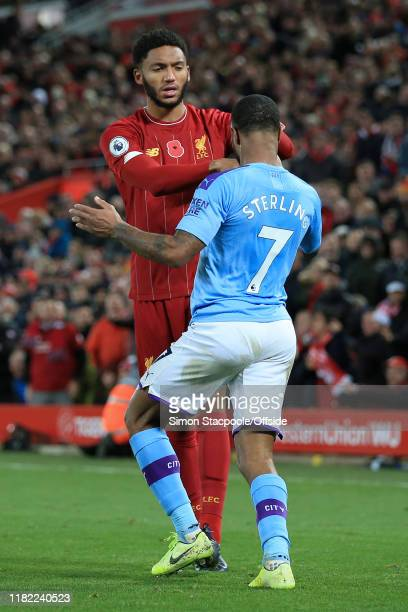 Joe Gomez of Liverpool pushes Raheem Sterling of Man City during the Premier League match between Liverpool FC and Manchester City at Anfield on...