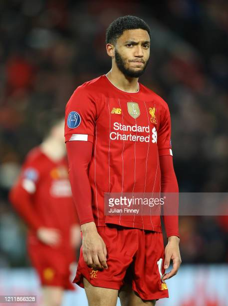 Joe Gomez of Liverpool reacts to defeat after the UEFA Champions League round of 16 second leg match between Liverpool FC and Atletico Madrid at...