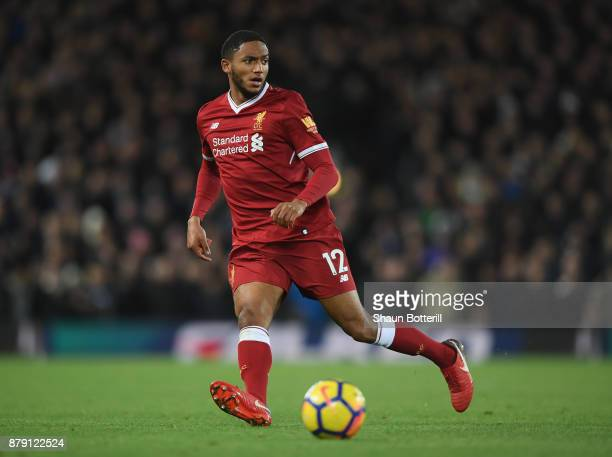 Joe Gomez of Liverpool runs with the ball during the Premier League match between Liverpool and Chelsea at Anfield on November 25 2017 in Liverpool...