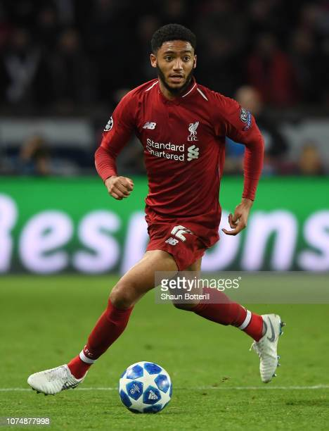 Joe Gomez of Liverpool runs with the ball during the UEFA Champions League Group C match between Paris SaintGermain and Liverpool at Parc des Princes...