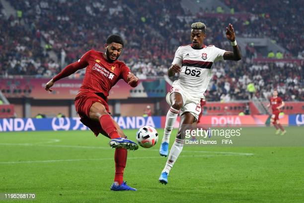 Joe Gomez of Liverpool shoots past Bruno Henrique of CR Flamengo during the FIFA Club World Cup Qatar 2019 Final match between Liverpool FC and CR...