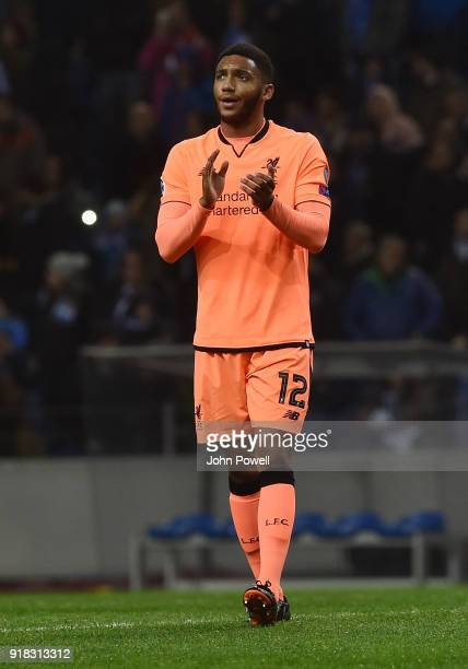 Joe Gomez of Liverpool shows his appreciation to the fans at the end of the UEFA Champions League Round of 16 First Leg match between FC Porto and...