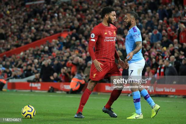 Joe Gomez of Liverpool squares up to Raheem Sterling of Man City during the Premier League match between Liverpool FC and Manchester City at Anfield...