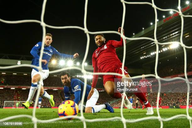 Joe Gomez of Liverpool stretches to clear the ball during the Premier League match between Liverpool FC and Everton FC at Anfield on December 2 2018...